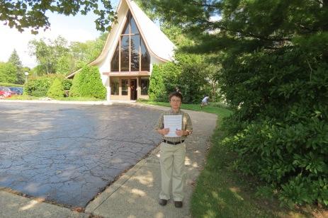 adam-in-front-of-church